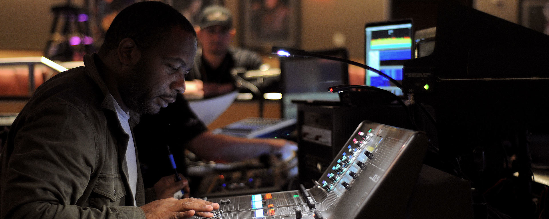 This image shows Schon Emmanuel in studio on his mixing console [Photo © Lee Everett]